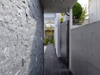 Casas de estilo asiático de 株式会社 入船設計 Asiático