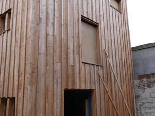 Extension en structure bois d'une maison individuelle. Maisons modernes par Architecte DPLG Moderne