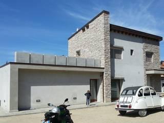 ラスティックな 家 の TuscanBuilding - Studio tecnico di progettazione ラスティック