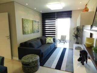 Projeto arquitetônico de interiores para residência unifamiliar. – (Fotos: Luiz Zanoni): Salas de estar  por ArchDesign STUDIO