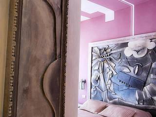 """Camera """"Lo Stregatto"""": Hotel in stile  di Studio Giorgi Barbieri Architetti"""