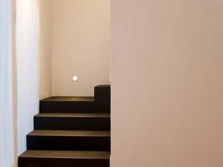 LOFT A MILANO: Case in stile in stile Moderno di BIFFI BONATO CLAUSETTI ARCHITETTI