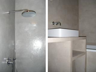 Appartement haussmannien: Salle de bains de style  par Atelier VVD