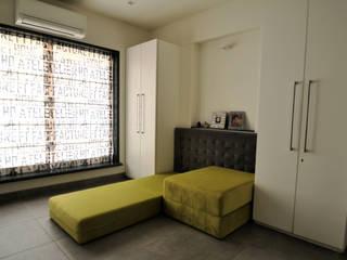 RESIDENCE AT VILE PARLE (E) Modern style bedroom by Dhruva Samal & Associates Modern