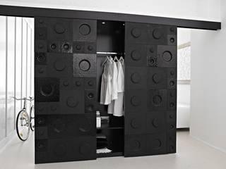 The Loft - armadio: Camera da letto in stile in stile Moderno di D.I. Più s.r.l - Andretto Design