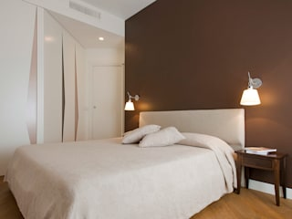 Appartamento a Garbatella: Camera da letto in stile  di Archifacturing