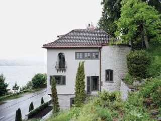 Haus am See Rustikale Häuser von Lando Rossmaier Architekten AG Rustikal