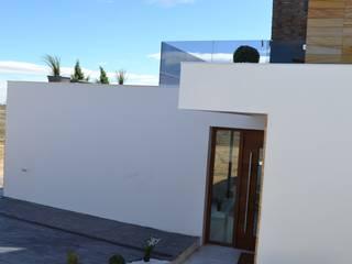 VIVIENDA UNIFAMILIAR AISLADA TOLEDO Casas de estilo moderno de AUNA ARQUITECTOS, S.L. Moderno