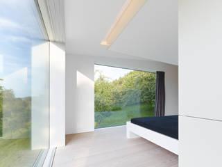 archifaktur Camera da letto minimalista