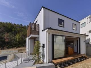 Casas de estilo moderno de 祐建築設計事務所 Moderno