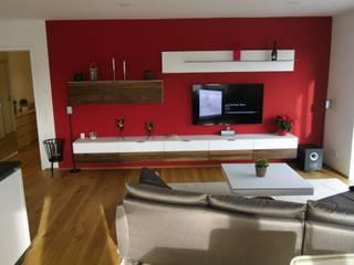 wohnen in urbanem Stil : moderne Wohnzimmer von Innenarchitektur-Moll