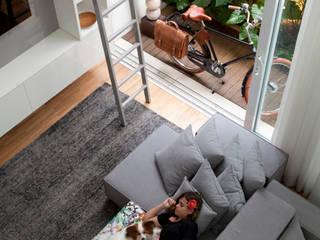 Casa do Itaim: Salas de estar  por Consuelo Jorge Arquitetos,
