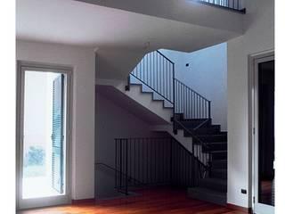 CASA UNIFAMILIARE: Case in stile  di BORGHI ARCHITECT& PARTNERS