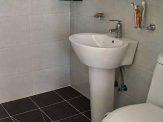 주택 리모델링: 해밀건축사사무소의  화장실