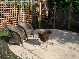 Fire bowl:  Balconies, verandas & terraces  by Fenton Roberts Garden Design
