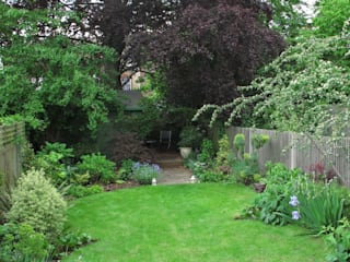 Garden with Oval Lawns Rustic style garden by Fenton Roberts Garden Design Rustic
