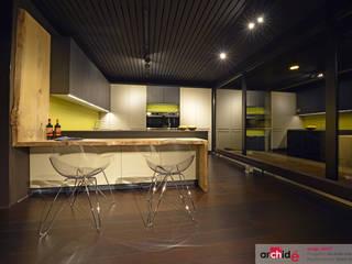 Minimalist kitchen by Archidé SA interior design Minimalist