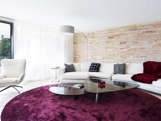 Modern living room by Förstl Naturstein Modern