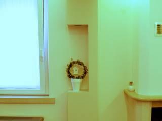 Sistemazione interni e nuova illuminazione casa di borgo di Architetto Lawrence Flisi Minimalista