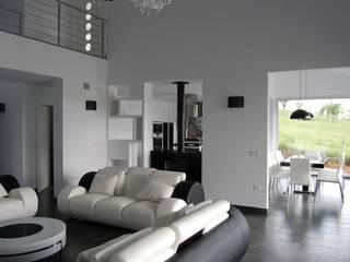 Vivienda Unifamiliar en Noreña: Salones de estilo  de Eva Fonseca estudio de arquitectura