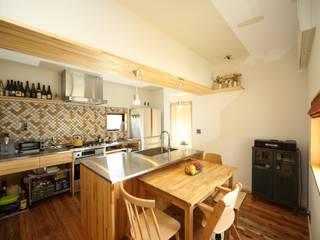 マキストーブのあるイエ モダンな キッチン の ツカ・デザインスタヂオ一級建築士事務所 モダン
