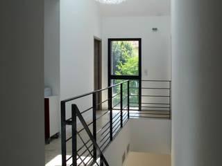 Modern corridor, hallway & stairs by Christian Fares Modern