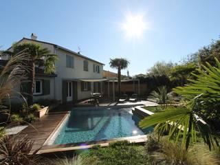 modern Pool by bureau d'etudes jardins KAEL