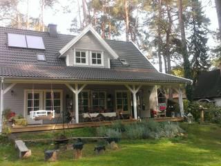Haustyp Axel mit Amerikanischer Terrasse:  Häuser von Akost GmbH  'Ihr Traumhaus aus Norwegen'