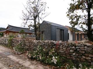 서측면 전시장 컨트리스타일 주택 by 201 건축사사무소 컨트리
