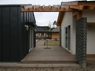 중앙 데크: 201 건축사사무소의  주택