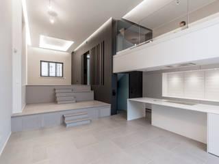 Maison unifamiliale à basse consommation d'énergie Salon moderne par RM archi sàrl Moderne