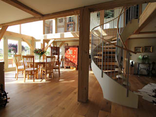 The kitchen/breakfast room and spiral stair: country Living room by Hale Brown Architects Ltd