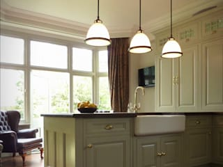 Kitchen renovation showing island, lights, cupboards and bay window: classic Kitchen by The Victorian Emporium