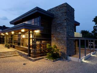 Naturstein trifft Stahl und Glas Ausgefallene Häuser von völse architekten bda Ausgefallen