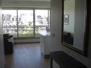 réhabilitation d'appartement  à Paris: Salle à manger de style  par CARTEL Architectes