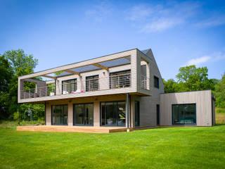 Casas de estilo moderno de ANTOINE LAINE ARCHITECTURES Moderno