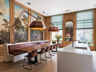 Modern en monumentaal wonen aan de gracht:   door Studio RUIM