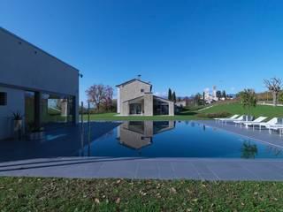 Piscinas de estilo  por Vegni Design, Moderno