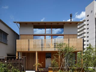 Eclectic style houses by でんホーム株式会社 Eclectic