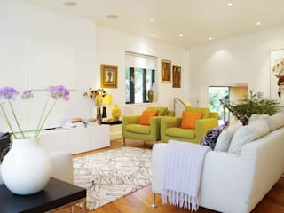 Colourful modern living room:  Living room by LLI Design
