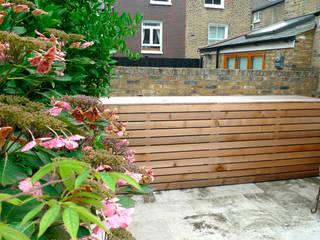 Small urban garden storage solution. Modern style gardens by wayne maxwell Modern