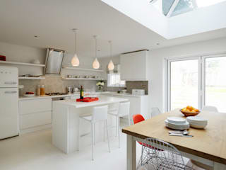 Bright, light Kitchen extension with roof lantern:  Kitchen by ZazuDesigns