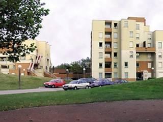 Réhabilitation HQE de 104 logements collectifs ZAC du Courghain à Grande Synthe (59):  de style  par Atelier E.S - Eric Stroobandt architecte dplg
