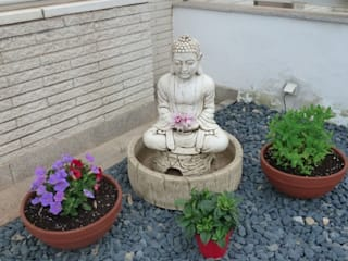 Asian style garden by Feng Shui Cristina Jové Asian