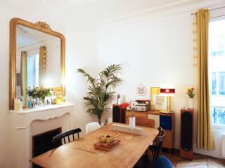 Rénovation complète d'un appartement : Salle à manger de style  par NELSON Architecture Intérieure & Design