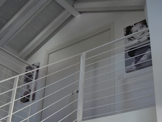 Modern corridor, hallway & stairs by Studio di architettura_Claudio Dorigo architetto Modern