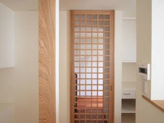 連島の家: 塚本雅久建築設計事務所が手掛けた壁です。