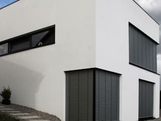 di architekturbüro Salas de entretenimiento de estilo minimalista