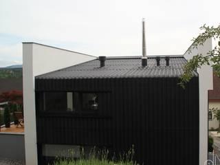 Casas de estilo minimalista de di architekturbüro Minimalista