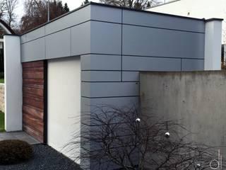 WOHNHAUS - FASSADENGESTALTUNG:  Garage & Schuppen von di architekturbüro